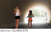 Купить «young women or female friends running outdoors», видеоролик № 32064374, снято 4 августа 2019 г. (c) Syda Productions / Фотобанк Лори