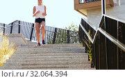 Купить «young woman running downstairs», видеоролик № 32064394, снято 4 августа 2019 г. (c) Syda Productions / Фотобанк Лори