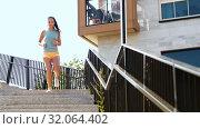 Купить «young woman running downstairs», видеоролик № 32064402, снято 4 августа 2019 г. (c) Syda Productions / Фотобанк Лори