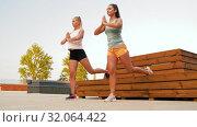 Купить «women training and doing single leg squats», видеоролик № 32064422, снято 4 августа 2019 г. (c) Syda Productions / Фотобанк Лори