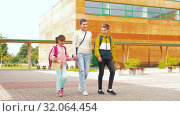 Купить «mother with son and daughter going to school», видеоролик № 32064454, снято 20 августа 2019 г. (c) Syda Productions / Фотобанк Лори