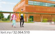 Купить «children with backpacks going to school», видеоролик № 32064510, снято 20 августа 2019 г. (c) Syda Productions / Фотобанк Лори