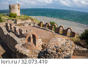 Купить «View of ruins of the Basilica of the Holy Mother of God Eleusa (6th century) and fortress tower in old town of Nessebar, Bulgaria», фото № 32073410, снято 26 июня 2019 г. (c) Юлия Бабкина / Фотобанк Лори