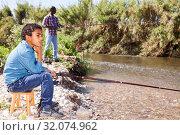 Купить «Man and boy fishing with rods», фото № 32074962, снято 26 мая 2019 г. (c) Яков Филимонов / Фотобанк Лори