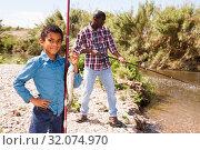 Купить «Boy and his father holding fish on hook», фото № 32074970, снято 26 мая 2019 г. (c) Яков Филимонов / Фотобанк Лори