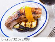 Купить «Roasted pork rib with cheese and eggplant», фото № 32075098, снято 17 февраля 2020 г. (c) Яков Филимонов / Фотобанк Лори