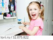 Funny lovely little girl painting. Стоковое фото, фотограф ivolodina / Фотобанк Лори