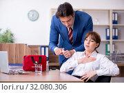 Купить «Young employee suffering in the office», фото № 32080306, снято 9 мая 2019 г. (c) Elnur / Фотобанк Лори
