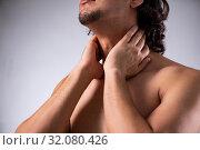 Купить «Young man suffering from neck pain», фото № 32080426, снято 25 мая 2019 г. (c) Elnur / Фотобанк Лори