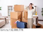 Купить «Young woman moving to new flat», фото № 32080778, снято 30 января 2019 г. (c) Elnur / Фотобанк Лори