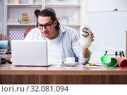 Купить «Young male designer working in the office», фото № 32081094, снято 4 апреля 2019 г. (c) Elnur / Фотобанк Лори