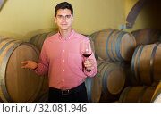 Купить «calm man posing in winery cellar», фото № 32081946, снято 21 сентября 2016 г. (c) Яков Филимонов / Фотобанк Лори