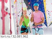 Купить «Two confident athletes at bouldering gym», фото № 32081962, снято 9 июля 2018 г. (c) Яков Филимонов / Фотобанк Лори