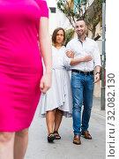 Купить «Angry female is jealousying because her boyfriend is staring on stranger girl», фото № 32082130, снято 18 октября 2017 г. (c) Яков Филимонов / Фотобанк Лори