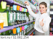 Купить «Happy young woman giving thumbs up in perfume shop», фото № 32082254, снято 24 апреля 2018 г. (c) Яков Филимонов / Фотобанк Лори
