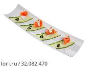 Купить «Appetizers with salmon, cheese and cucumber», фото № 32082470, снято 20 ноября 2019 г. (c) Яков Филимонов / Фотобанк Лори