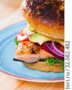 Купить «Hamburger made with trout fillet», фото № 32082482, снято 20 сентября 2019 г. (c) Яков Филимонов / Фотобанк Лори