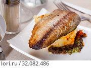 Купить «Fried scomber with potatoes», фото № 32082486, снято 25 января 2020 г. (c) Яков Филимонов / Фотобанк Лори