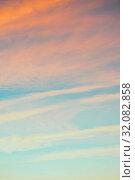 Купить «Небесный пейзаж. Закатное небо. Blue sky background - picturesque colorful clouds lit by sunlight, pink pastel tones applied», фото № 32082858, снято 4 ноября 2018 г. (c) Зезелина Марина / Фотобанк Лори