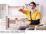 Купить «Young man after car accident suffering at home», фото № 32082874, снято 21 февраля 2019 г. (c) Elnur / Фотобанк Лори