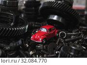 Купить «red car on the background of old spare parts», фото № 32084770, снято 27 августа 2019 г. (c) Дмитрий Бачтуб / Фотобанк Лори
