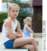Купить «Small sisters upset after quarrel outside», фото № 32091350, снято 20 июля 2017 г. (c) Яков Филимонов / Фотобанк Лори