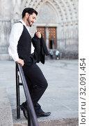 Man standing near iron handrails. Стоковое фото, фотограф Яков Филимонов / Фотобанк Лори