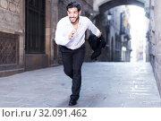 Купить «Emotional man in formalwear running», фото № 32091462, снято 5 августа 2017 г. (c) Яков Филимонов / Фотобанк Лори