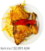 Купить «Baked chicken with red paprika and french fries at plate», фото № 32091634, снято 20 сентября 2019 г. (c) Яков Филимонов / Фотобанк Лори
