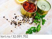 Купить «Image of pickled squids in American Salsa sauce in open tin can», фото № 32091702, снято 17 сентября 2019 г. (c) Яков Филимонов / Фотобанк Лори