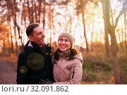 Купить «couple on walk in autumn park.», фото № 32091862, снято 21 сентября 2019 г. (c) Дарья Филимонова / Фотобанк Лори