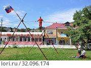Купить «Russia, Dagestan, Majalis, tightrope walker», фото № 32096174, снято 19 сентября 2018 г. (c) age Fotostock / Фотобанк Лори