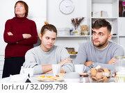 Купить «Young couple offended after quarrel with mother», фото № 32099798, снято 27 ноября 2017 г. (c) Яков Филимонов / Фотобанк Лори