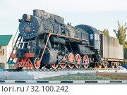 "Купить «Engels, Saratov region, Russia - 08/24/2019: Monument to trains ""Steam locomotive series L"". Old locomotive locomotive on rails, a landmark of the city», фото № 32100242, снято 24 августа 2019 г. (c) Светлана Евграфова / Фотобанк Лори"