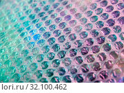 Holographic background in the style of the 80-90s. Real texture of bubble wrap film in bright acid colors. Стоковое фото, фотограф bashta / Фотобанк Лори