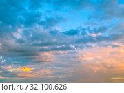 Купить «Небесный закатный пейзаж. Голубое небо. Blue dramatic evening sky background. Picturesque colorful clouds lit by sunset light. Vast sky landscape panoramic scene, colorful sky view», фото № 32100626, снято 14 июня 2018 г. (c) Зезелина Марина / Фотобанк Лори