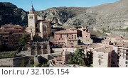 Купить «Aerial view of Albarracin - medieval town with fortress wall on hillside, Spain», видеоролик № 32105154, снято 25 декабря 2018 г. (c) Яков Филимонов / Фотобанк Лори