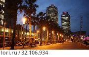 Купить «view of Barceloneta beach with Mapfre tower and Arts Hotel in Barcelona in night», видеоролик № 32106934, снято 13 июня 2019 г. (c) Яков Филимонов / Фотобанк Лори