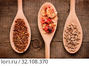 Three wooden spoon with muesli and flax seed and sunflower seed. Стоковое фото, фотограф Zoonar.com/Andreas Berheide / easy Fotostock / Фотобанк Лори
