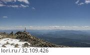 Купить «Time lapse of cloudscape behind of the mountains top. Snow, rocks, cliffs and deep blue sky. High altitude.», видеоролик № 32109426, снято 24 июля 2019 г. (c) Александр Маркин / Фотобанк Лори