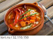 Купить «Soup of bean with boiled carrots, pepper and greens, served in bowl», фото № 32110150, снято 19 сентября 2019 г. (c) Яков Филимонов / Фотобанк Лори