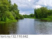 Summer landscape of a calm oxbow lake with wooded shores. Стоковое фото, фотограф Евгений Харитонов / Фотобанк Лори