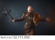 Купить «Bearded viking with axe enters the battle», фото № 32111050, снято 27 марта 2019 г. (c) Tryapitsyn Sergiy / Фотобанк Лори