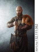 Купить «Viking with axe, nordic barbarian image», фото № 32111062, снято 27 марта 2019 г. (c) Tryapitsyn Sergiy / Фотобанк Лори