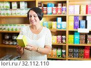 Купить «Cheerful mature woman in store», фото № 32112110, снято 21 сентября 2019 г. (c) Яков Филимонов / Фотобанк Лори