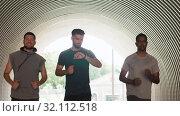 Купить «young men or male friends running outdoors», видеоролик № 32112518, снято 27 июля 2019 г. (c) Syda Productions / Фотобанк Лори