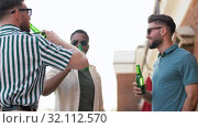 Купить «happy male friends drinking beer at rooftop party», видеоролик № 32112570, снято 27 июля 2019 г. (c) Syda Productions / Фотобанк Лори