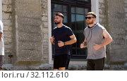 Купить «young men or male friends running outdoors», видеоролик № 32112610, снято 27 июля 2019 г. (c) Syda Productions / Фотобанк Лори