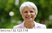 Купить «portrait of happy senior woman at summer park», видеоролик № 32123118, снято 25 августа 2019 г. (c) Syda Productions / Фотобанк Лори