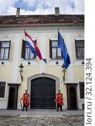 Купить «The Changing of the Guard, Croatian soldiers in historical regalia in ceremonial parade at St Mark's Square, Zagreb, Croatia.», фото № 32124394, снято 3 августа 2019 г. (c) age Fotostock / Фотобанк Лори